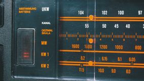 Tuning Analog Radio Dial Frequency on Scale of the Vintage Receiver. The frequency label moves in the range 89 - 108 MHz, and also over long, medium and short stock footage