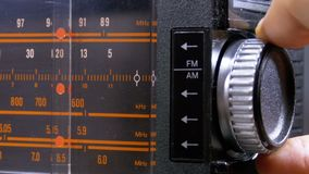 Tuning analog radio dial frequency on scale of the vintage receiver. The frequency label moves in the range 89 - 108 MHz, and also over long, medium and short stock video footage