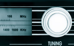 Tuning button. Old radio tuning button (focus on button Royalty Free Stock Photos