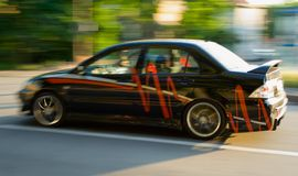 Tuning Car. A black car, with red design Royalty Free Stock Images
