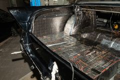 Tuning the car in a sedan body with three layers of noise insulation of the trunk. Audio and vibration isolation. Soft material. Dismantled car. Additional stock images