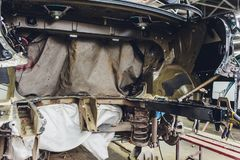Tuning the car in a sedan body with three layers of noise insulation of the trunk. Audio and vibration isolation. Soft. Material. Dismantled car. Additional royalty free stock photo