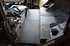 Tuning the car in a SUV body with three layers of noise insulation on the floor. Sound and vibration isolation using soft and. Pimply material with a car stock images
