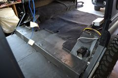 Tuning the car in a SUV body with three layers of noise insulation on the floor. Sound and vibration isolation using soft and. Pimply material with a car stock photography