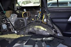 Tuning the car in a SUV body with three layers of noise insulation on the floor. Sound and vibration isolation using soft and. Pimply material with a car royalty free stock images