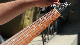 Tuning Electric Guitar stock video