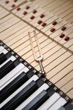 Tuning Fork. Over piano keys royalty free stock photo