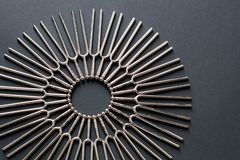 Tuning fork circular pattern on a black background with copy space royalty free stock photo