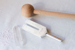 Tuning fork. And crystal on a table Stock Images