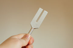 Tuning fork. On a fabric Stock Photo