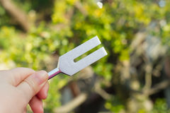 Tuning fork. On a fabric Stock Image