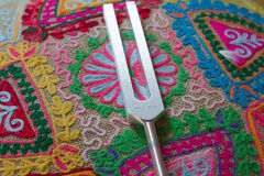Tuning fork. On a fabric Royalty Free Stock Images