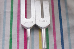 Tuning fork. On a fabric Stock Photography