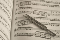 Tuning fork on music Royalty Free Stock Photos