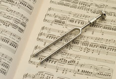 Tuning fork and music royalty free stock image