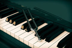 Tuning Fork on top of Piano Keys. 3d Rendering Royalty Free Stock Image