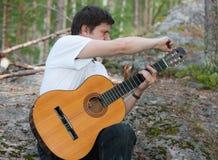 Tuning of guitar Stock Image