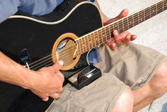 Tuning a Guitar Royalty Free Stock Photos