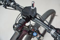 Tuning biycle handlebar. Tuning handlebar to fit the front wheel with laser Stock Photos