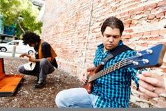 Tuning his guitar Stock Image