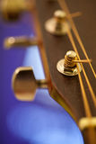 Tuning pegs of an acoustic guitar Royalty Free Stock Photos