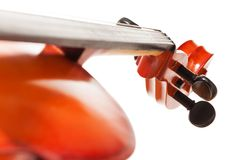 Tuning pegs view of cello on white background Royalty Free Stock Photography