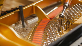 Tuning Piano with Audio. Close up shot of tuning piano with audio stock footage