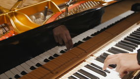 Tuning Piano with Audio. Flowing shot of tuning piano with audio stock video footage