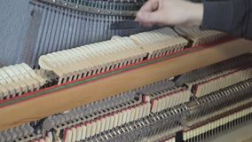 Tuning Piano. Close up shot of tuning piano.  stock footage