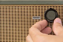 Tuning radio knob. Hand with tuning radio knob Royalty Free Stock Image