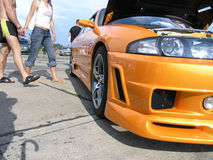 Tuning show. Front of an orange Nissan Skyline at a local tuning show Royalty Free Stock Photography