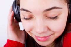 Tuning In To. Young girl listening/feeling music her eyes shut. Perhaps classical Stock Photo