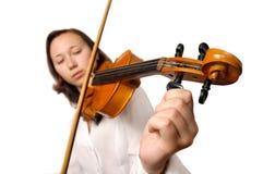 Tuning violin. Girl tuning violin isolated silhouette on white background. Half korean half european gilr royalty free stock photos