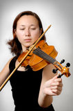 Tuning Violin. Girl tuning violin isolated silhouette stock images