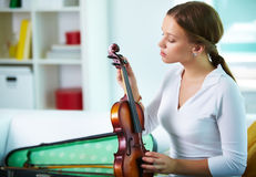 Tuning the violin Royalty Free Stock Images