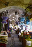 Street Market Tunis, Old Medina Arched Alley -  Colorful Arabic Rugs and Spice Royalty Free Stock Images