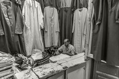 Tunis tailor. Shop of chilabas in the souk of Tunis Stock Image