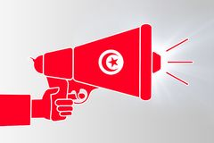 Illustration of megaphone gun with Tunisian flag. TUNIS, TUNISIA, 14 January 2018 - Illustration showing Tunisian protestors fighting for free speech Royalty Free Stock Images