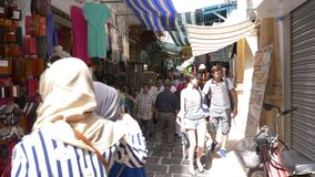 Tunis, Tunisia - 06 June 2018: Arabian women walking on local market Tourist people shopping souvenirs and gifts on arab