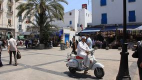 Tunis, Tunisia. TUNISIA, TUNIS, JUNE 30, 2010: Street in Tunis, Tunisia. Man riding a scooter, Tunisia, Tunis, June 30, 2010 stock footage