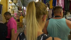 Tunis, Tunisia - 06 June 2018: tourist people walking arabian souk and looking souvenirs and gifts in old Medina city. Arab sellers working on traditional stock video footage