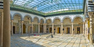 In Madrasa Bir Lahjar, Tunis. TUNIS, TUNISIA - SEPTEMBER 2, 2015: The covered courtyard of Bir Lahjar Madrasa with preserved arcades and tile decors with Islamic Royalty Free Stock Images