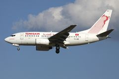 Tunisair Boeing 737-600. Tunisian Tunisair Boeing 737-600 with registration TS-IOM on short final for runway 01 of Brussels Airport royalty free stock images
