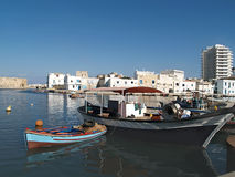 Tunisia. Tunisia. bizerte fishing boats white buildings waterfront marina city african blue sky and water Stock Photo