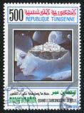 """Woman. TUNISIA - CIRCA 1992: stamp printed by Tunisia, shows """"When the Subconscious Awakes"""" by Moncef ben Amor, circa 1992 royalty free stock photos"""