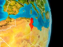 Tunisia on Earth. Tunisia in red on planet Earth with visible borderlines. 3D illustration. Elements of this image furnished by NASA Stock Photography
