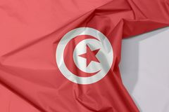 Tunisia fabric flag crepe and crease with white space. Tunisia fabric flag crepe and crease with white space, red and white flag with star and crescent in stock images