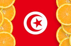 Tunisia flag in citrus fruit slices vertical frame. Tunisia flag in vertical frame of orange citrus fruit slices. Concept of growing as well as import and export royalty free stock image