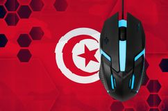 Tunisia flag and computer mouse. Concept of country representing e-sports team. Tunisia flag and modern backlit computer mouse. Concept of country representing e royalty free stock photography