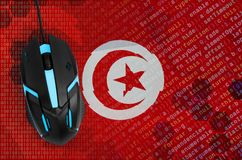 Tunisia flag and computer mouse. Digital threat, illegal actions on the Internet. Tunisia flag and modern backlit computer mouse. The concept of digital threat stock photos